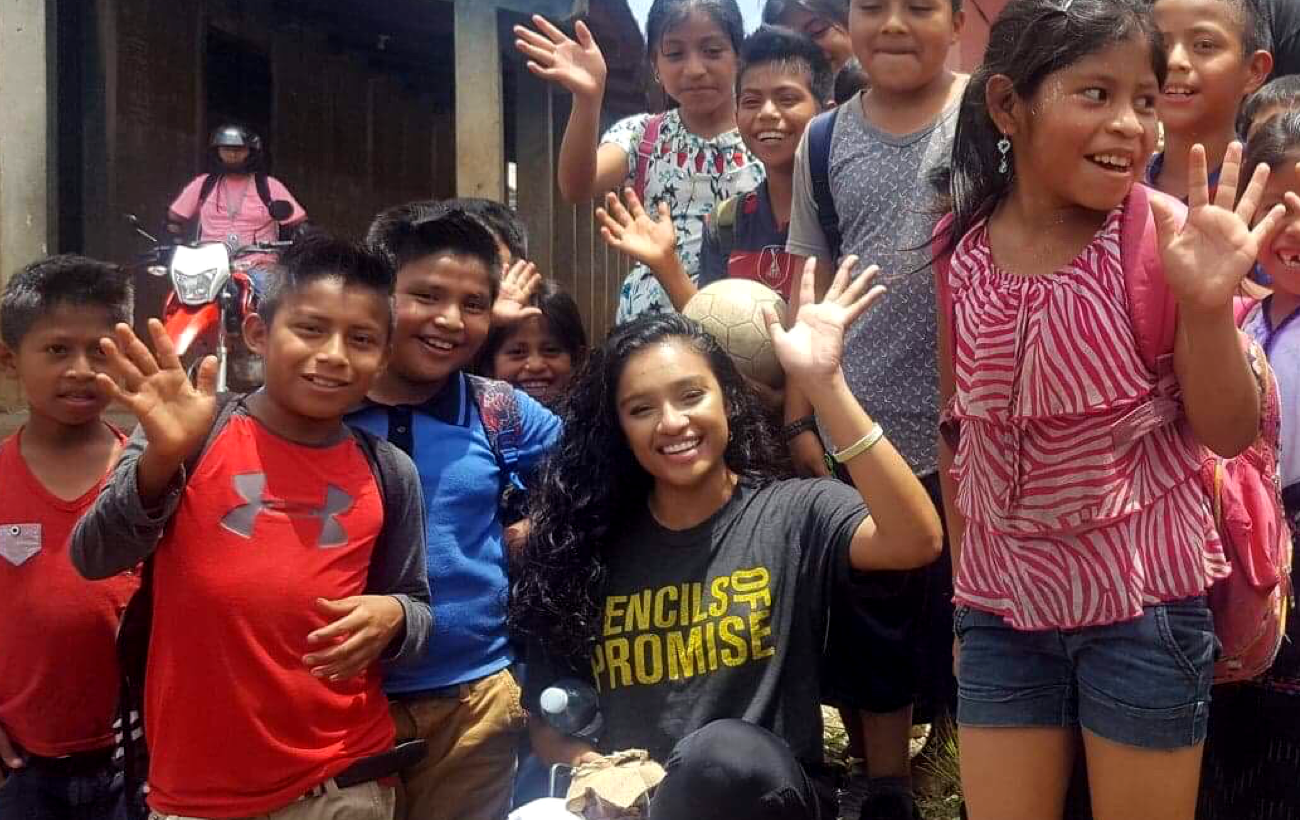 Kavitha with children in Guatemala