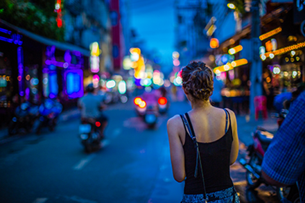 Image Women looking down street at night in Thailand